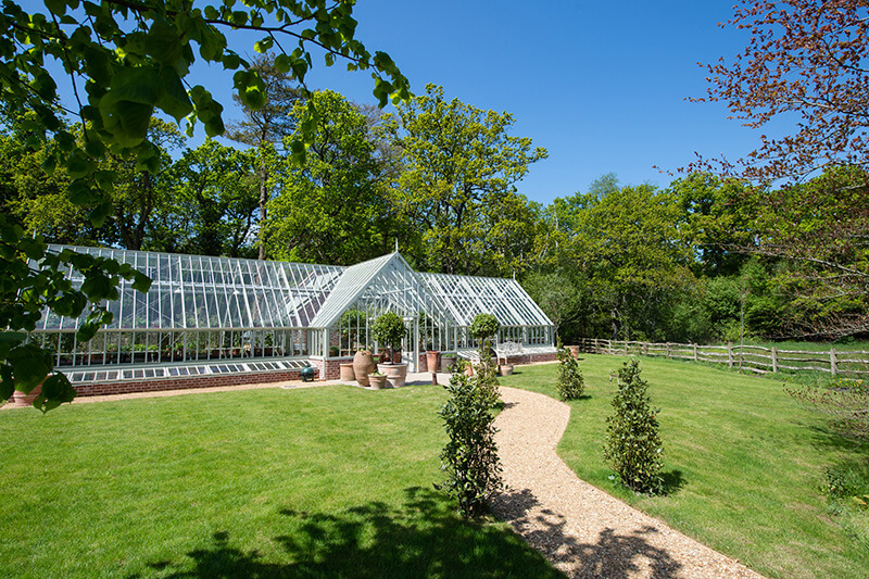 External shot of greenhouse at Lime Wood Hotel | Marston & Langinger
